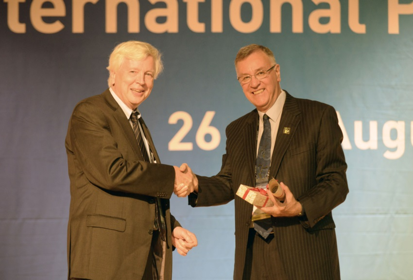 Peter McDonald presenting the 2013 IUSSP Laureate Award to John Bongaarts.